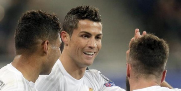 Real Madrid's Cristiano Ronaldo, center, celebrates his side's 4th goal with teammates  during the Champions League Group A soccer match between FC Shakhtar and Real Madrid at Arena Lviv stadium in Lviv, Western Ukraine, Wednesday, Nov. 25, 2015. (AP Photo/Efrem Lukatsky)