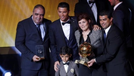 FIFA Ballon d'Or winner Ronaldo poses with his mother Maria Dolores dos Santos Aveiro and son Ronaldo Jr. after the FIFA Ballon d'Or 2014 soccer awards ceremony in Zurich