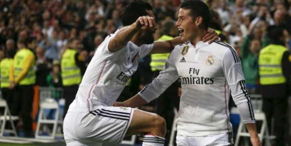 Real Madrid's James Rodriguez celebrates his goal against Malaga with his teammate Alvaro Arbeloa during their Spanish First Division soccer match at Santiago Bernabeu stadium in Madrid