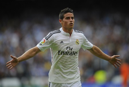 Real Madrid's Colombian midfielder James Rodriguez celebrates after scoring during the Spanish league football match RC Deportivo de la Coruna vs Real Madrid CF at the Municipal de Riazor stadium in La Coruna on September 20, 2014.   AFP PHOTO/ MIGUEL RIOPAMIGUEL RIOPA/AFP/Getty Images ORG XMIT: 504076097 ORIG FILE ID: 533600238