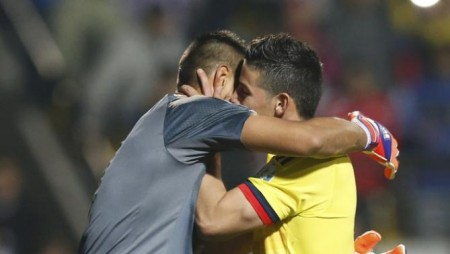 Colombia's James Rodriguez greets Argentina's goalie Sergio Romero after scoring on him during penalties following the end of regulation play in their Copa America 2015 quarter-finals soccer match at Estadio Sausalito in Vina del Mar, Chile, June 26, 2015. REUTERS/Ueslei Marcelino