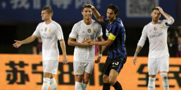 Real Madrid's Cristiano Ronaldo, centre left interacts with Inter Milan's Andrea Ranocchia, centre right, during the International Champions Cup soccer match in Guangzhou in south China's Guangdong province, Monday, July 27, 2015. Real Madrid defeated Inter Milan 3-0. (Color China Photo via AP) CHINA OUT