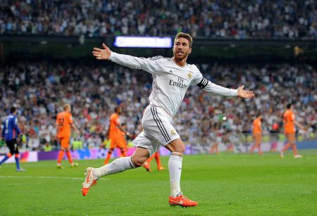 MADRID, SPAIN - MAY 04:  Sergio Ramos of Real Madrid FC celebrates after scoring Real's opening goal during the La Liga match between Real Madrid CF and Valencia CF at Santiago Bernabeu stadium on May 4, 2014 in Madrid, Spain.  (Photo by Denis Doyle/Getty Images)