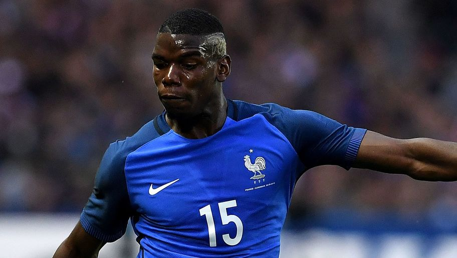 France's midfielder Paul Pogba passes the ball during the friendly football match between France and Cameroon, at the Beaujoire Stadium in Nantes, western France, on May 30, 2016. / AFP / FRANCK FIFE (Photo credit should read FRANCK FIFE/AFP/Getty Images)