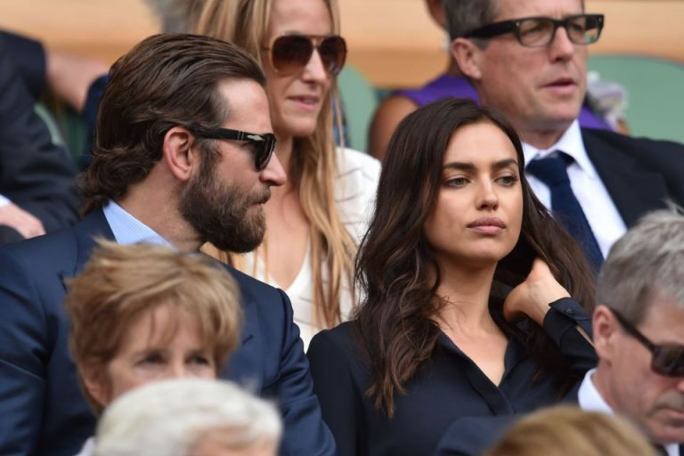 US actor Bradley Cooper and Russian model Irina Shayk sit in the royal box on centre court before the start of the men's singles final match on the last day of the 2016 Wimbledon Championships at The All England Lawn Tennis Club in Wimbledon, southwest London, on July 10, 2016. / AFP PHOTO / GLYN KIRK / RESTRICTED TO EDITORIAL USEGLYN KIRK/AFP/Getty Images